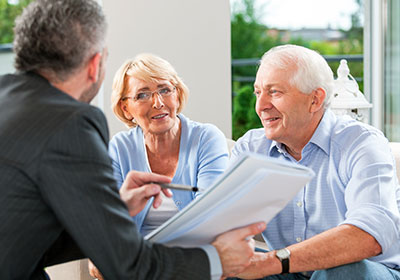 Elderly couple talking to insurance agent
